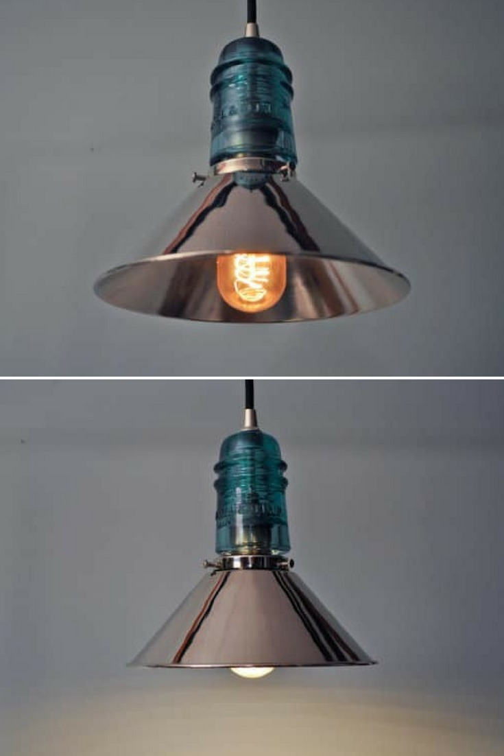 A modern industrial design pendant lamp created from an antique glass electrical insulator and chrome metal shade. This design looks wonderful mounted in a kitchen, bar or any other place in your household. #diylighting #edison #glasslamp #industrial #kitchendecor #lamp #lampshade #lightbulb #lighting #lightingdesign #metallic #modernlighting #pendantlamp #recycle #vintagelighting