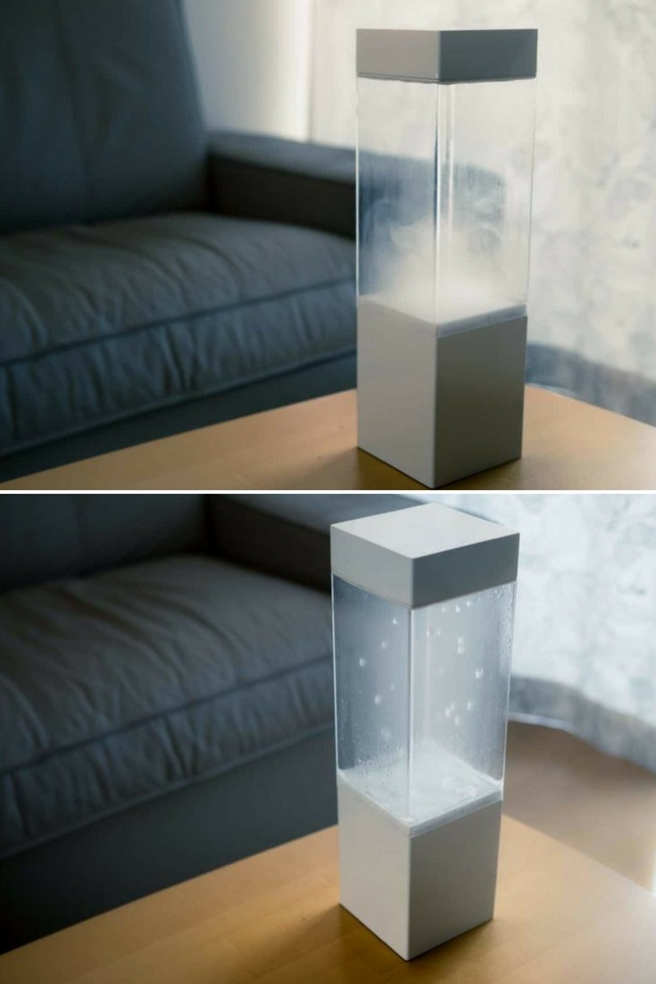 The Tempescope is an ambient physical display that visualizes various weather conditions like rain, clouds, and lightning. By receiving weather forecasts from the internet, it can reproduce tomorrow\'s sky in your living room. #bottlelamp #concept #lamp #lighting #lightingdesign #modernlighting #tablelamp