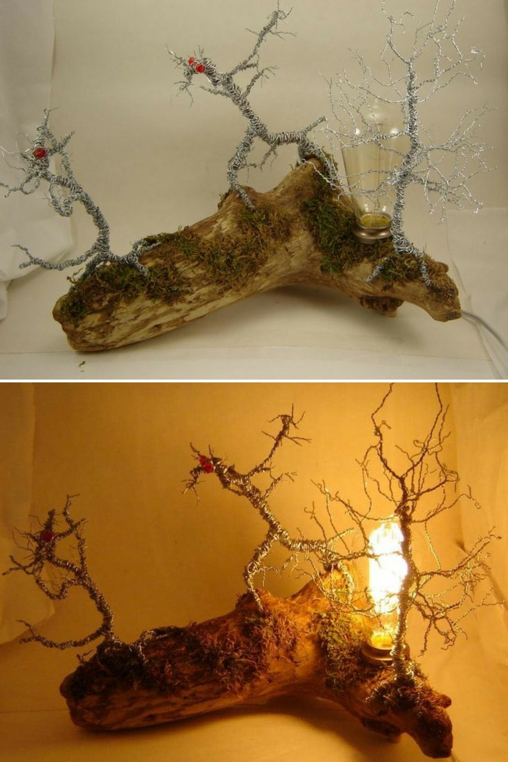 An original driftwood desk lamp and wire tree sculpture with swamp monsters. Woodland decor. A lighted sculpture that is made with 2 swamp monsters and a wire tree mounted on a moss covered driftwood piece that has a satin varnished finish. #concept #desklamp #diylighting #driftwood #edison #handmadelighting #lamp #led #lightfixture #lighting #lightingdesign #recycle #rusticlighting #vintagelighting #woodworking