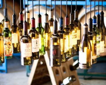 30 Wine Bottle Light Chandelier Hanging from Wood Rack
