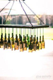 30 Wine Bottle Light Chandelier Hanging From Wood Rack