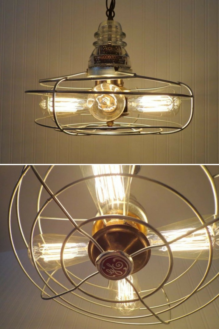 Great chandelier pendant lighting using a variety of old metal components dating back to the early 1900\'s in brass, chrome and iron. The rustic vintage lamp fan cage has the original emblem stating \'GE\' and an antique Glass Insulator. #christmasideas #diylighting #handmadelighting #industrial #lamp #lighting #lightingdesign #modernlighting #recycle #tablelamp #woodlamp #woodworking