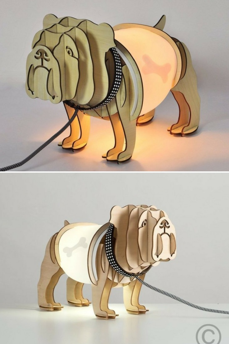 A fantastic table lamp - Intricate wooden profiles in the shape of a bulldog. The area of the stomach contains the bulb and when lit, reveals - as an xray - the dog\'s bone consumed. The effect is completed by the diamond encrusted collar and the leash (thread with textile coating). Sure to be the focal point in all sets and sure to be the focus of the conversation. #bedside #concept #handmadelighting #lamp #lightbulb #lighting #lightingdesign #modernlighting #tablelamp #woodlamp #woodworking