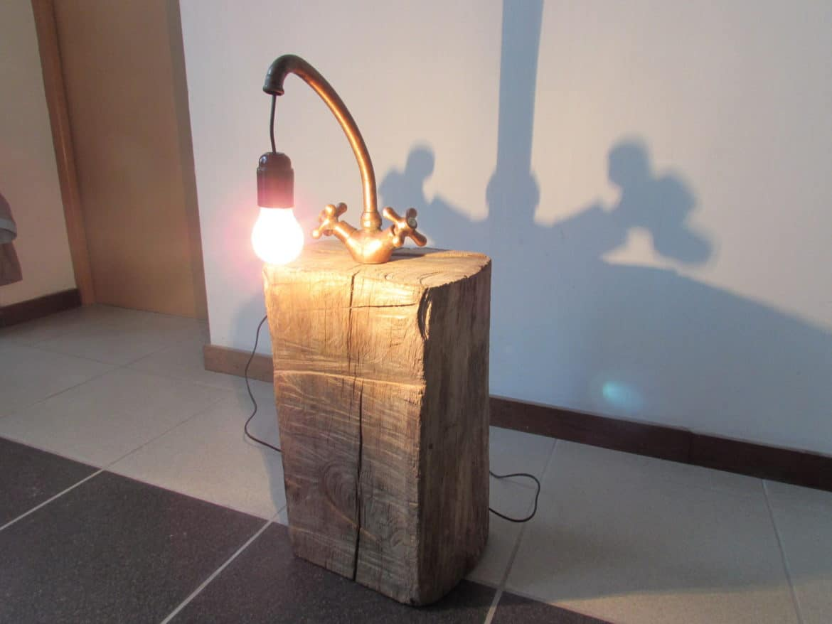 Copper Faucet Lamp on Wood Log